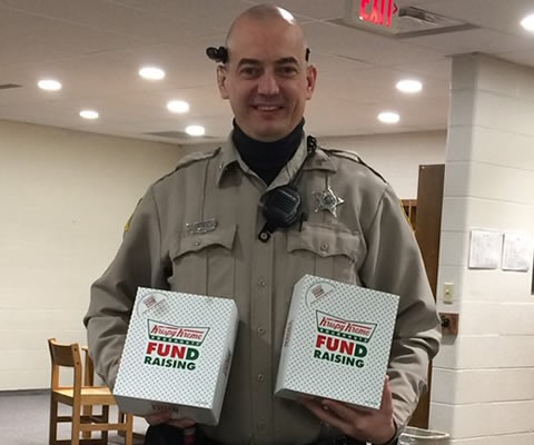 SRO Pederson helping out a senior trip fundraiser by buying two boxes of Donuts